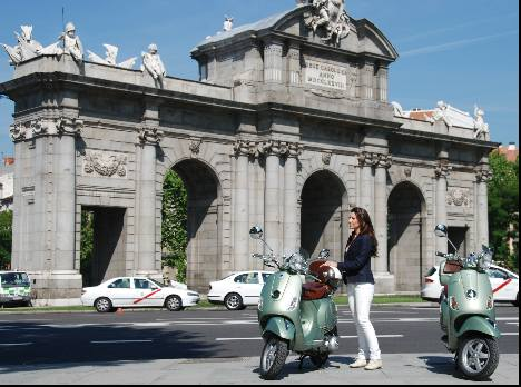 Madrid vespa in front of the Puerta de Alcala