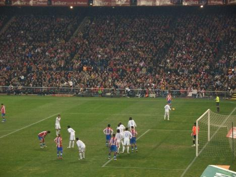 Atletico Madrid players attack the Real Madrid goal